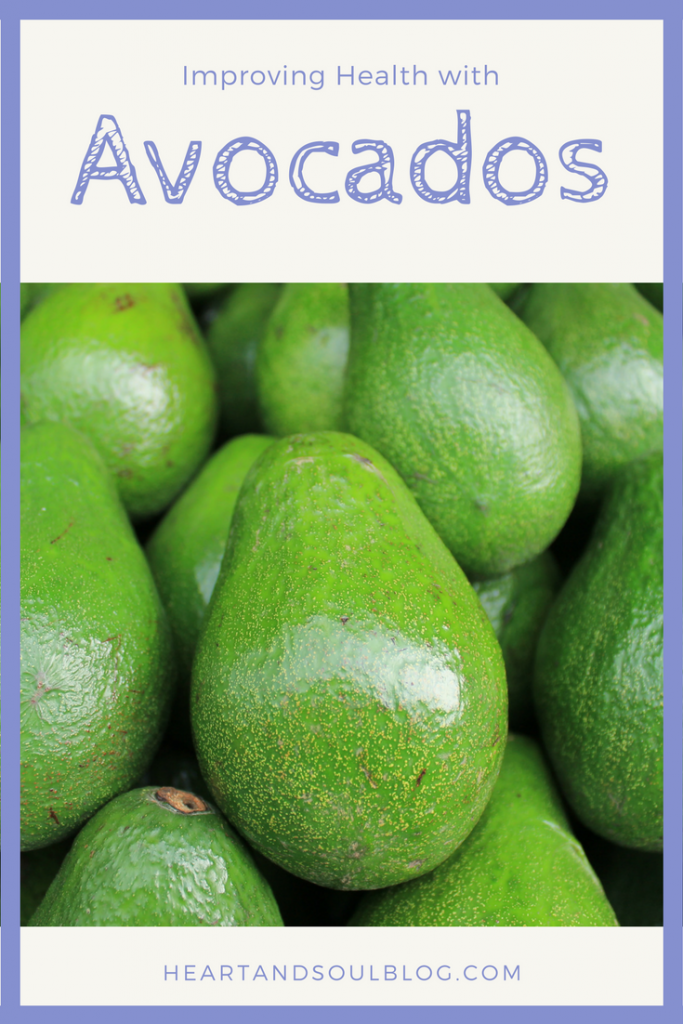 """A pile of avocados with the blog title """"Improving Your Health with Avocados"""""""