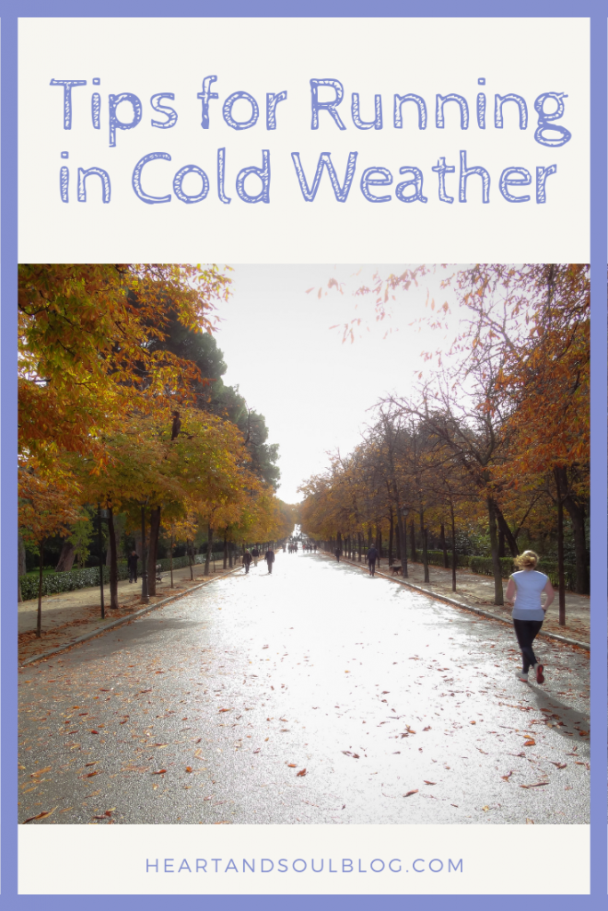 "A blonde white woman runs down a road lined with fall trees with the title, ""Tips for Running in Cold Weather"""