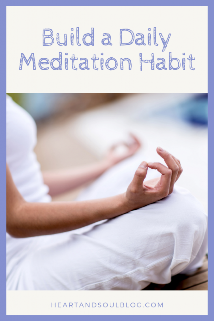 "image of light-skinned woman meditating with the title ""Build a Daily Meditation Habit"""