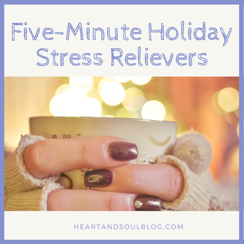 "White hands with painted fingernails and fingerless gloves hold a mug in front of holiday lights with the title, ""Five-Minute Holiday Stress Relievers"""