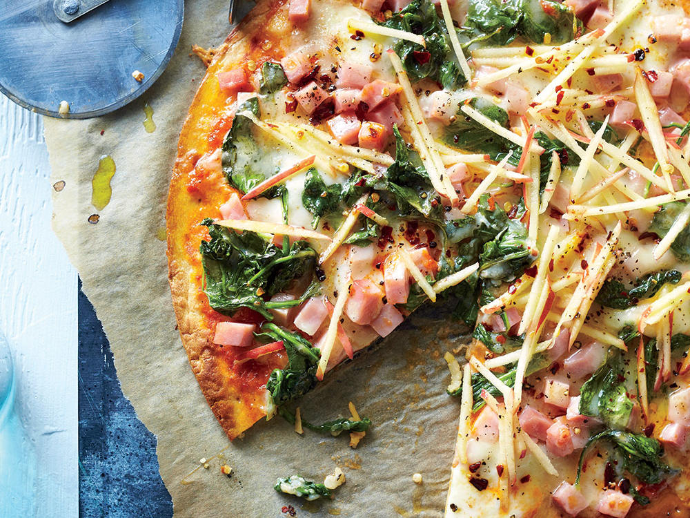 Pizza with ham and spinach and mozzarella cheese and brown crust