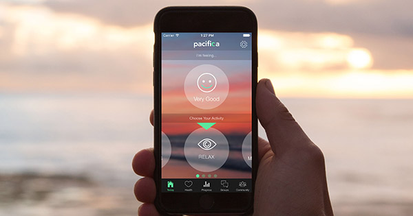 phone using Pacifica app at the beach