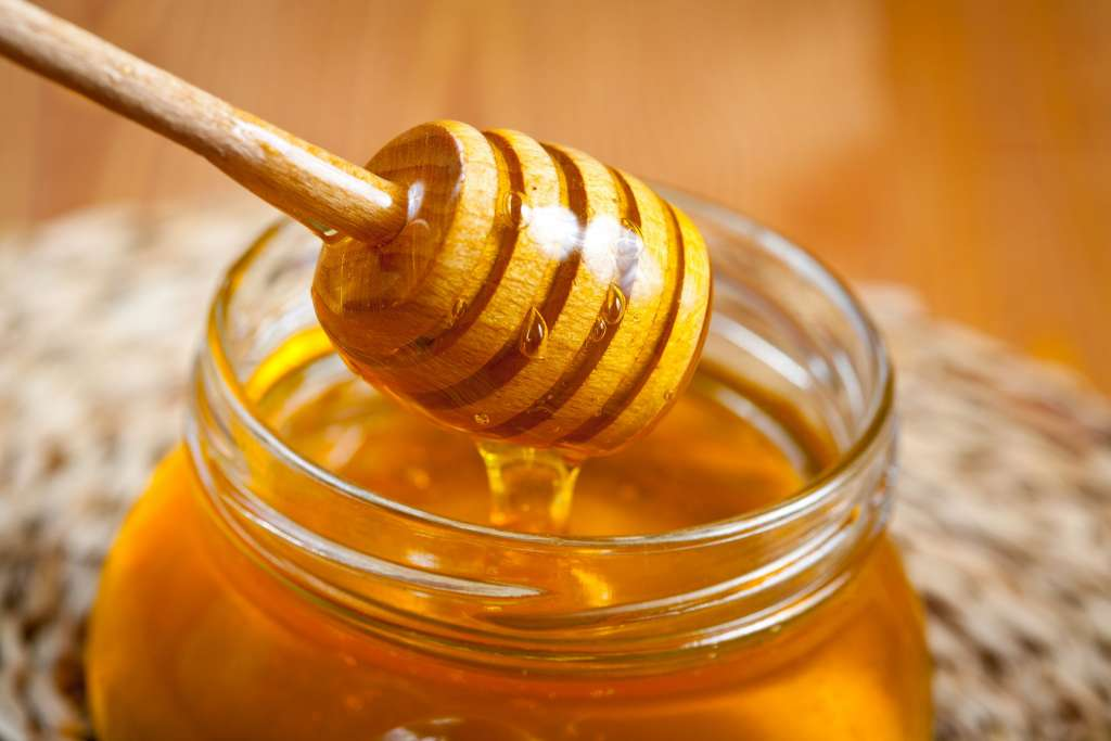 honey dripping from the jar