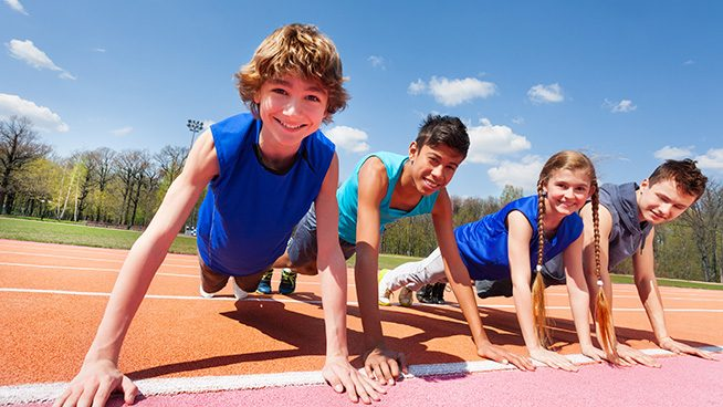 kids doing pushups on track course
