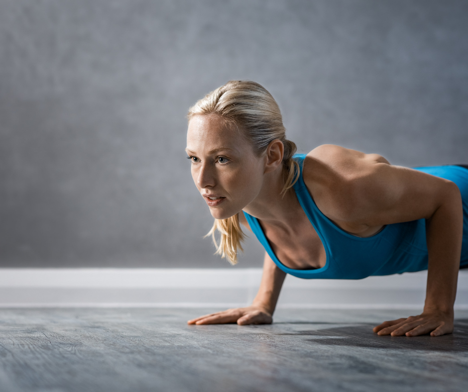 woman in blue workout suit doing pushups