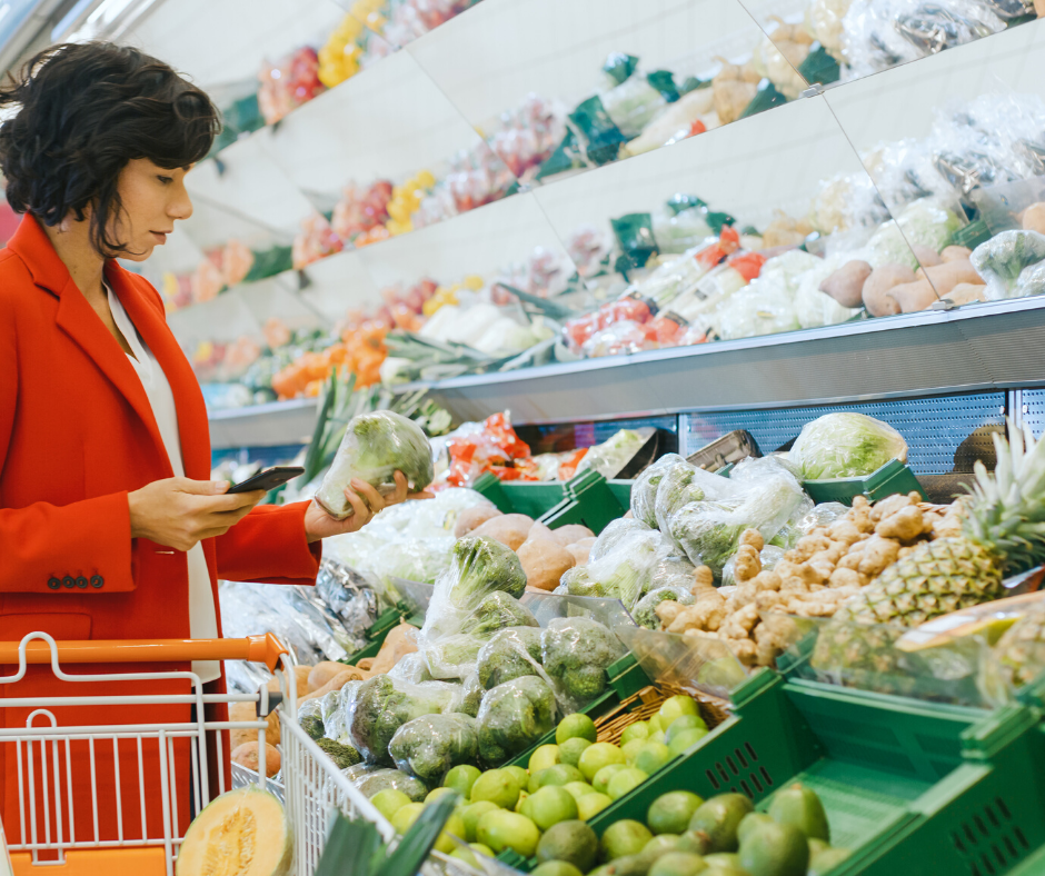 woman grocery shopping in produce aisle