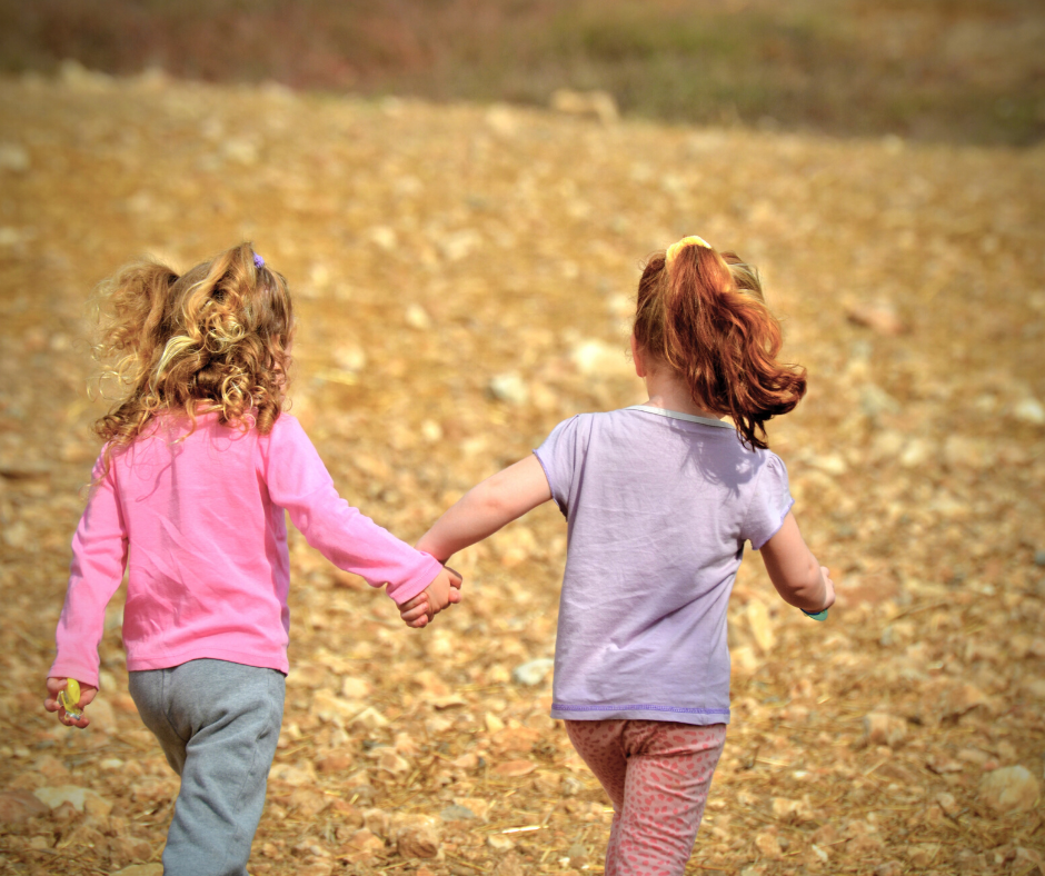 girls running outside practicing healthy activities